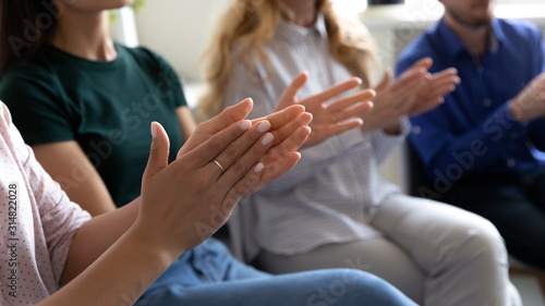 Fototapeta Grateful audience applauding thanking coach for presentation closeup clapping hands obraz
