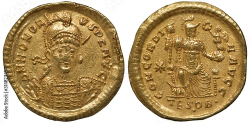 Fotografía Ancient Roman Empire golden coin solidus 408-423 AD, armored and helmeted bust o