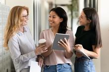 Colleagues During Break Meet In Office Hall Enjoy Informal Talk