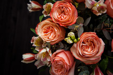 Dark Luxurious Bouquet Of Gorgeous Pink Roses For Valentine's Day On A Dark Wood Background