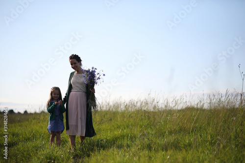 Fotografie, Tablou  Mother with daughter walking on a road