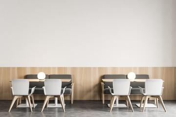 Modern white restaurant interior with armchairs