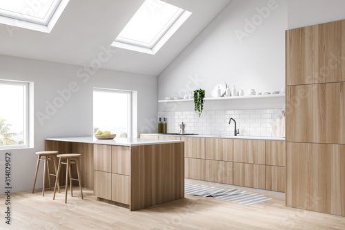 Fototapeta Attic white kitchen corner with bar obraz