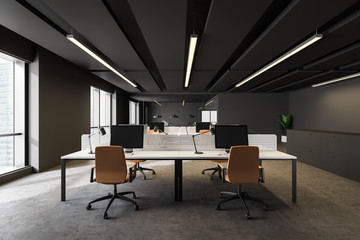 Dark gray open space office with orange chairs