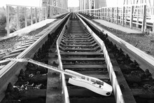 Black And White Electric Guitar On The Railroad Tracks And Stones