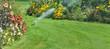 sprinkler in the lawn watering flowers in a beautiful garden in summer