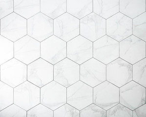 Tiles. A white marble wall with hexagon tiles for texture and background.