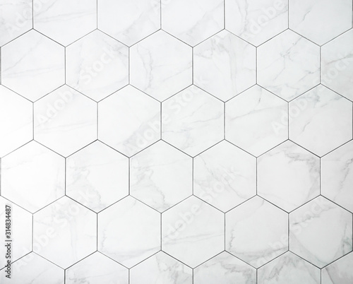 Fototapeta Tiles. A white marble wall with hexagon tiles for texture and background. obraz