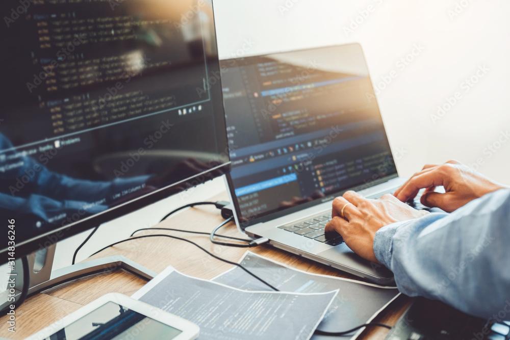 Fototapeta Developing programmer Development Website design and coding technologies working in software company office