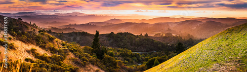 Expansive panorama in Santa Cruz mountains, with hills and valleys illuminated by the sunset light; San Francisco Bay Area, California - 314837435