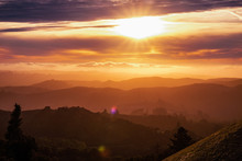 Sunlight Bursting Through The Clouds And Illuminating The Hills And Valleys Of Santa Cruz Mountains; Clouds Covering The Sky And The Pacific Ocean; San Francisco Bay Area, California