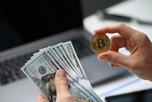 Male Hand Holds Bitcoin And Do...