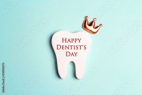 Happy Dentist's Day concept with tooth in the crown. Canvas Print