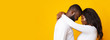 Leinwandbild Motiv Happily married black couple hugging over yellow background