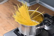 canvas print picture - Spaghetti boiling in steel pan. Italian raw spaghetti.