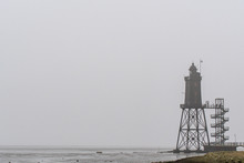 Old Lighthouse With Low Tide A...