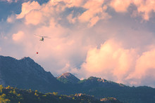 Helicopter Extinguish A Fire In Mountains