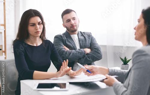 Deceived couple disputing about mortgage loan with realtor Slika na platnu