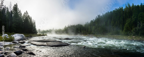 Obraz Siberian Balyiktyig hem river in Sayan mountains in early foggy morning. - fototapety do salonu