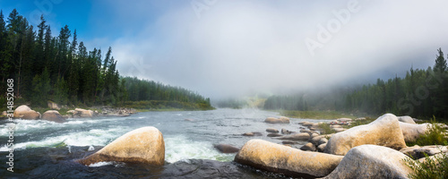 Fototapeta Siberian Balyiktyig hem river in Sayan mountains in early foggy morning. obraz