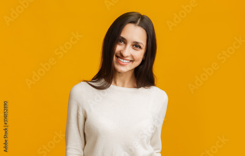 Obraz na plátně  Portrait of young middle eastern girl smiling and looking at camera