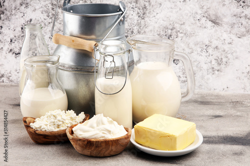 Fototapeta Different  healthy dairy products on rustic background with milk, cheese, butter and cottage obraz