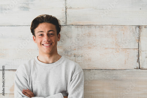 Slika na platnu one teenager at home smiling happy at the camera - simple photo of handsome youn