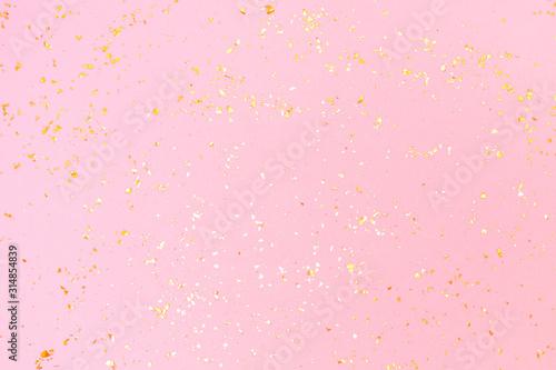 Fototapeta Golden sparkles on pink pastel trendy background. Festive backdrop for your projects. obraz na płótnie