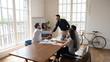 Smiling multiethnic businessmen handshake at office meeting