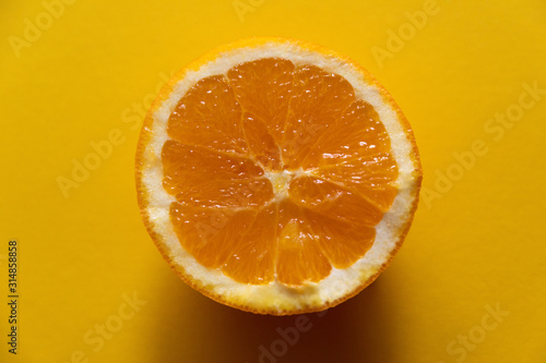 half of orange on yellow background