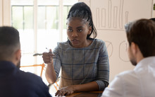 Serious Ethnic Businesswoman T...