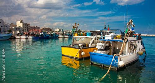 Obraz Fishing boats at the old port of Porto Vecchio in Monopoli Puglia Italy - fototapety do salonu