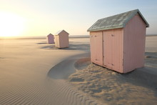 Some Small Wooden Houses On The Beach. Bercq A City In The North Of France.