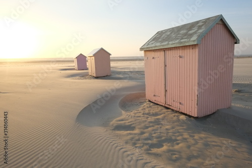 Fototapeta Some small wooden houses on the beach. Bercq a city in the north of France. obraz