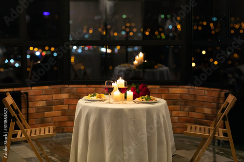 Served Table With Food And Burning Candles In Restaurant Interior Wallpaper Mural