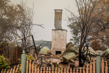 Australian Bushfire Aftermath: A Lonely Chimney On Burnt Building Remains In Blue Mountains, Australia