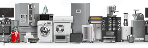 Photo Household and kitchen appliances and home technics in a row