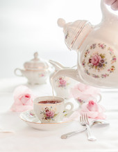 Tea Time Served With  Fine China Porcelain Set With Floral Pattern.
