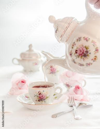 Fototapeta Tea time served with  fine china porcelain set with floral pattern.  obraz