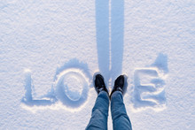 Valentine's Day Card With The Word Love In The Snow