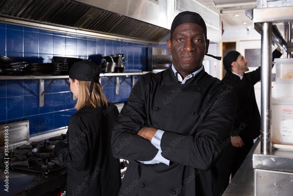 Fototapeta African American chef in restaurant kitchen