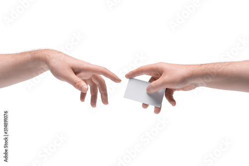 Photo Two male hands passing one another blank business card on white background