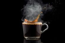 Splash And Splatter From A Piece Of Sugar In A Mug With Coffee On A Black Background