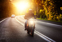 Driving A Motorcycle On A Sunn...