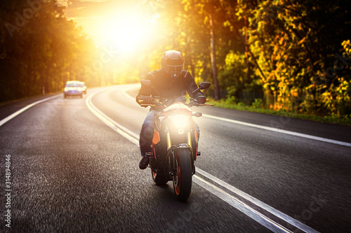 driving a motorcycle on a sunny day Wallpaper Mural