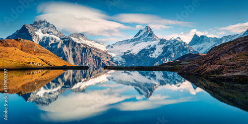 Fotografie, Obraz Panoramic morning view of Bachalp lake / Bachalpsee, Switzerland
