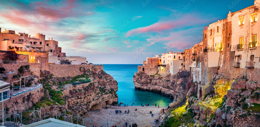 Fototapeta Spectacular spring cityscape of Polignano a Mare town, Puglia region, Italy, Europe. Colorful evening seascape of Adriatic sea. Traveling concept background..