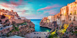 Leinwanddruck Bild Spectacular spring cityscape of Polignano a Mare town, Puglia region, Italy, Europe. Colorful evening seascape of Adriatic sea. Traveling concept background..