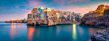 Panoramic Spring Cityscape Of Polignano A Mare Town, Puglia Region, Italy, Europe. Superb Sunrise View Of Adriatic Sea. Traveling Concept Background.