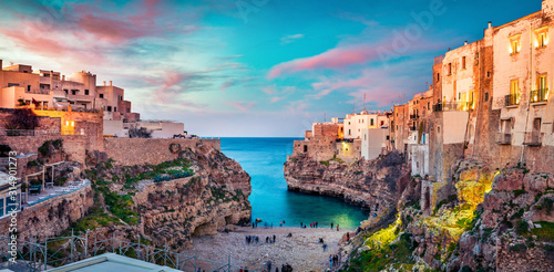 Fototapeta Spectacular spring cityscape of Polignano a Mare town, Puglia region, Italy, Europe. Colorful evening seascape of Adriatic sea. Traveling concept background.. obraz